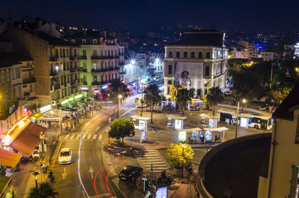 A long exposure at night of the bus station at the City Hall in Cannes, France