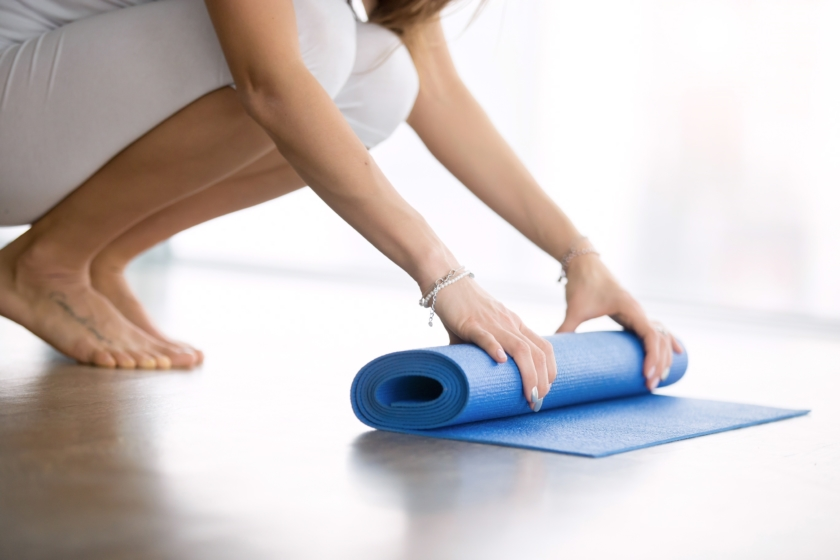 Unrolling Pilates mat
