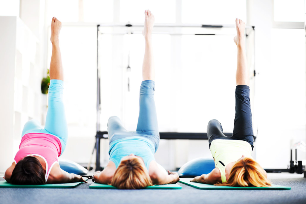 Pilates class with reformer machine