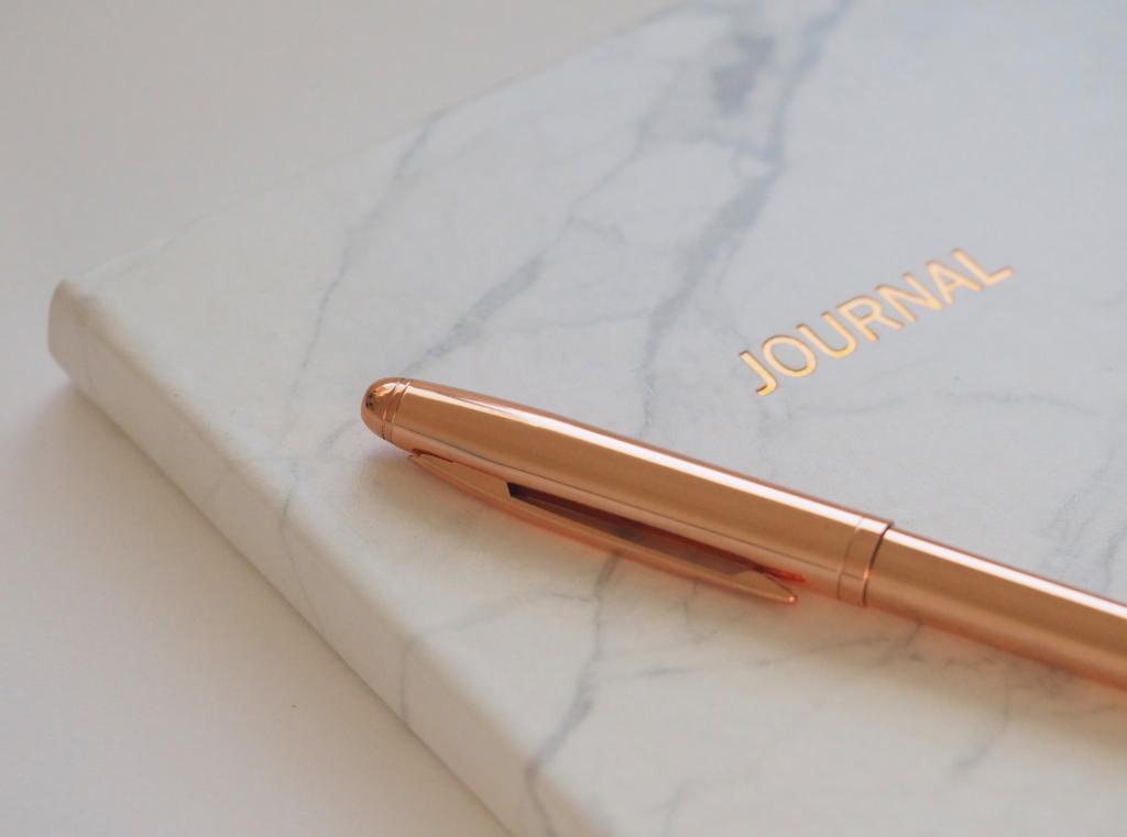 journalist journal and pen