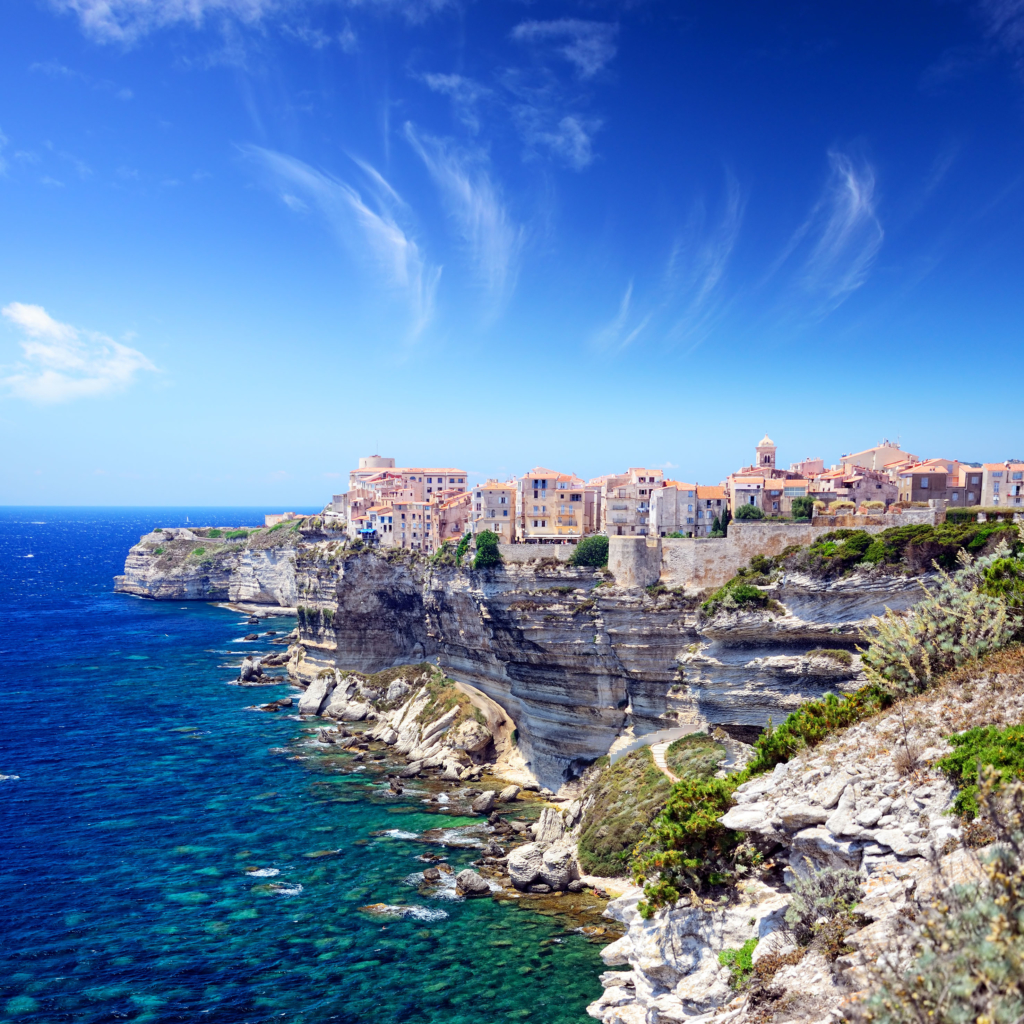 Houses of Bonifacio atop steep cliffs above the Mediterranean sea, Corsica, France