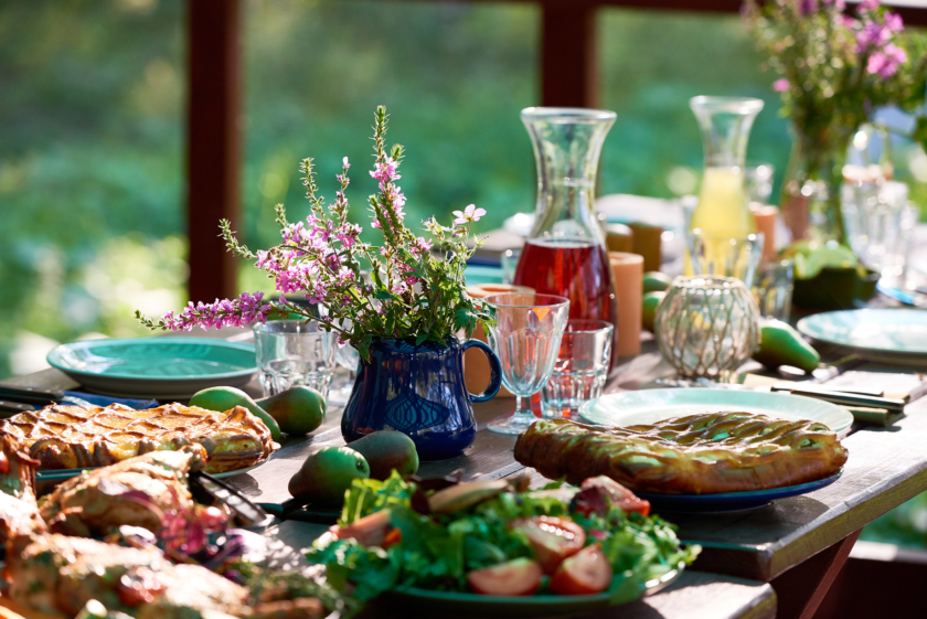 Outdoor living: table with food and drinks on it