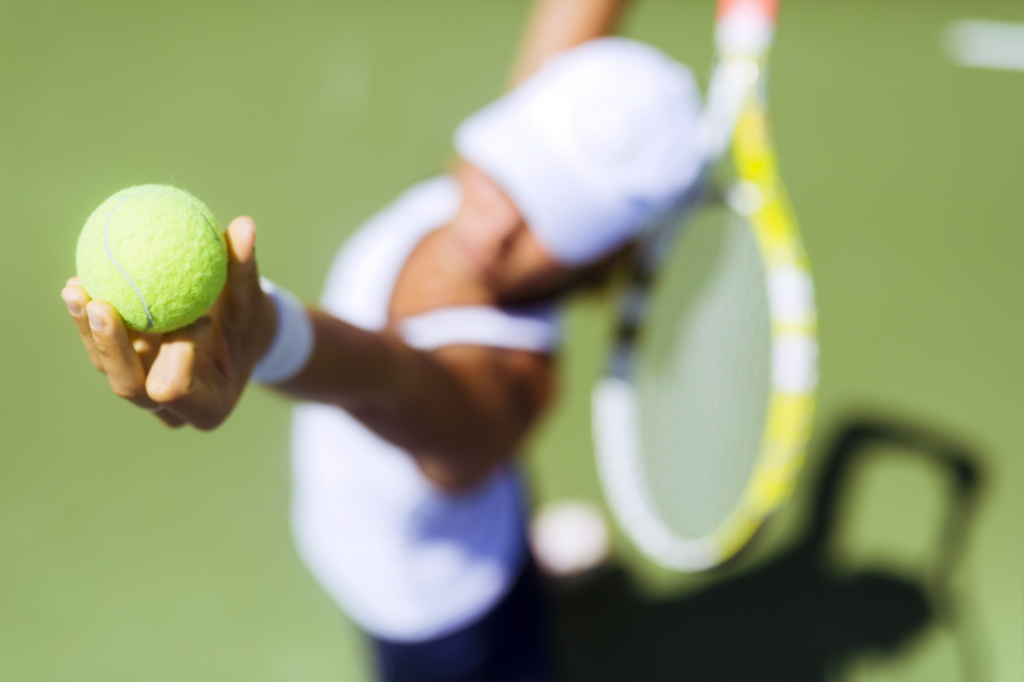 Benefits of tennis woman serving