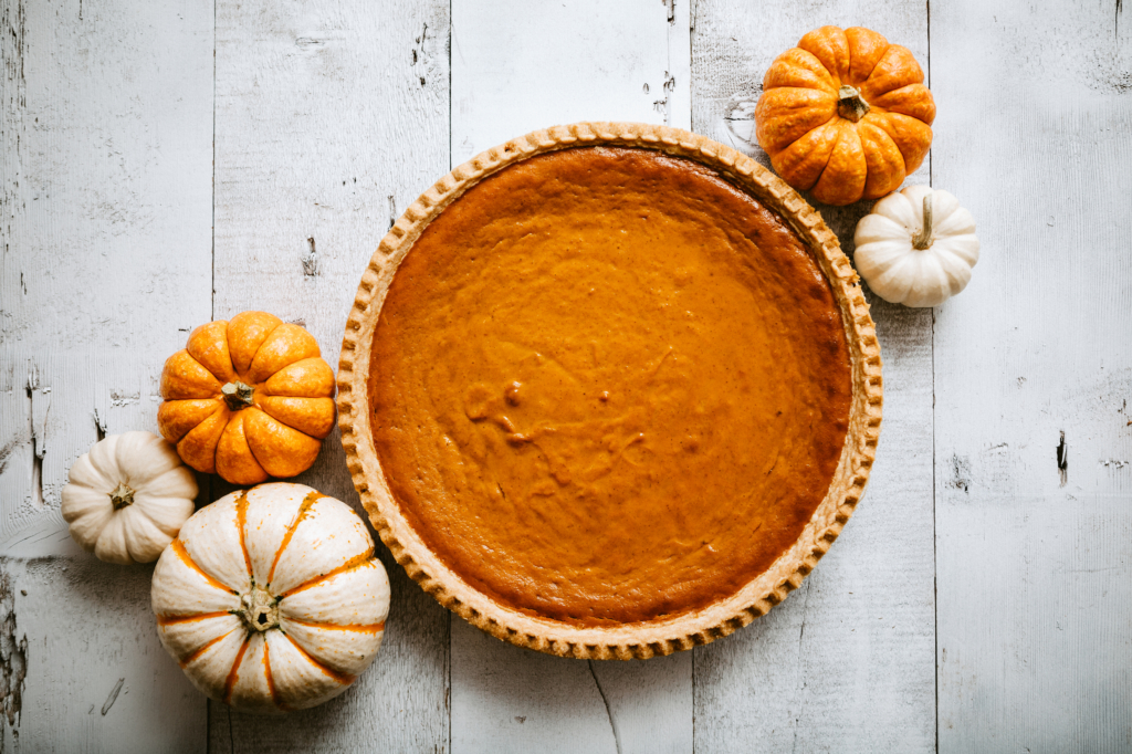 autumn food Pumpkin Pie on Rustic Background