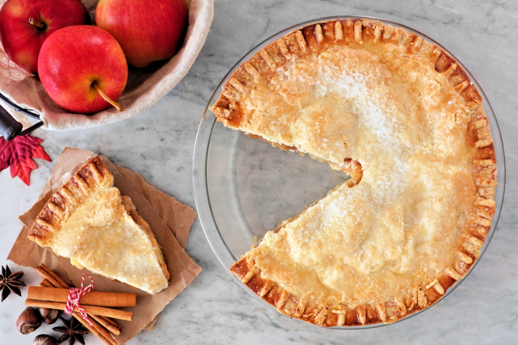 autumn food Apple pie, overhead scene with cut slice on marble background