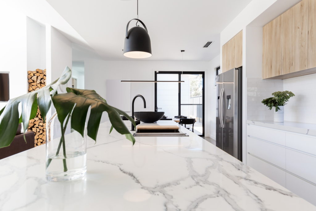 kitchen design Kitchen marble bench close up with black hanging pendant