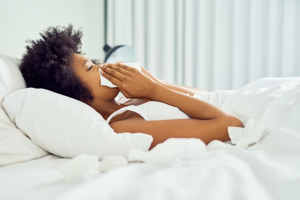How to fight flu woman staying in bed