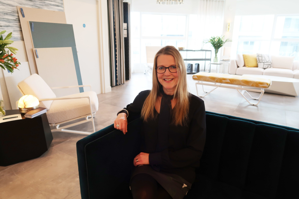 London Design Week Sarah Worswick at Fox Linton on Stuart Scott Furniture sofa