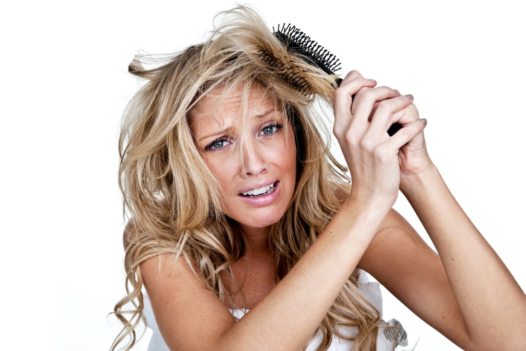 hairdresser Woman having a bad hair with roller brush stuck in her hair