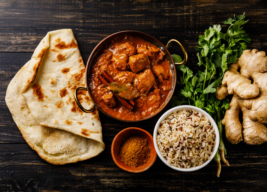irritable bowel syndrome Chicken tikka masala spicy curry meat food with rice and naan bread