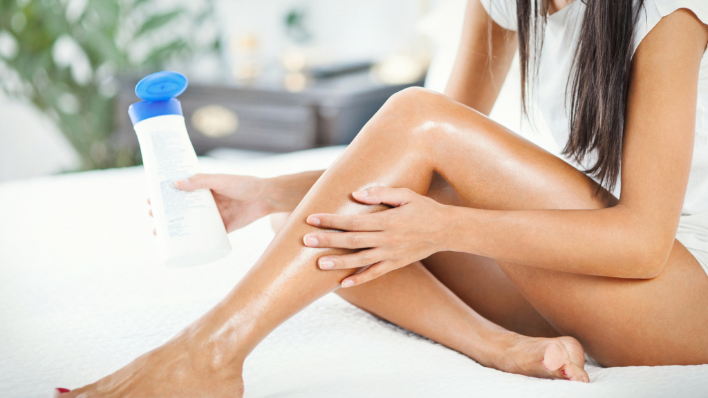 fake tan after-care Woman applying some lotion onto her legs.