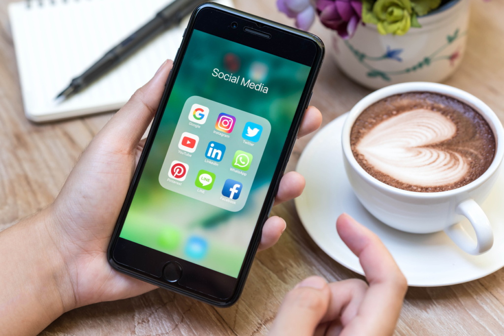 Social media channels on an iphone including Pinterest for business