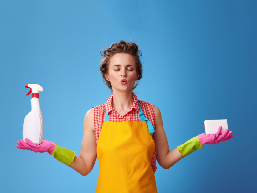 eco friendly cleaning products woman with kitchen sponge and a bottle of detergent doing yoga