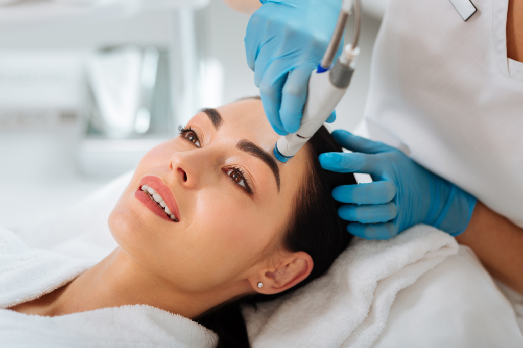 How to look younger Delighted nice woman enjoying the hydrafacial procedure