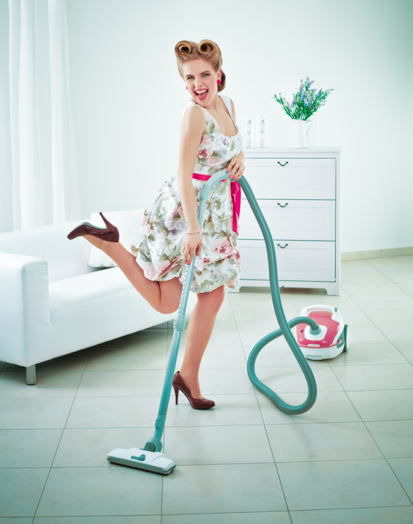 eco-friendly cleaning products Retro housewife vacuuming a floor