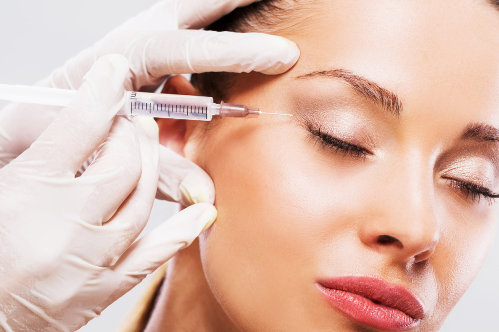 How to look younger Woman with her eyes closed receiving Botox injection.