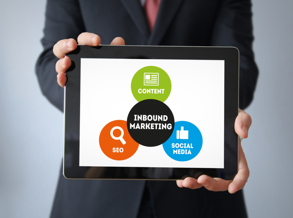 businessman with Inbound marketing concept on a tablet