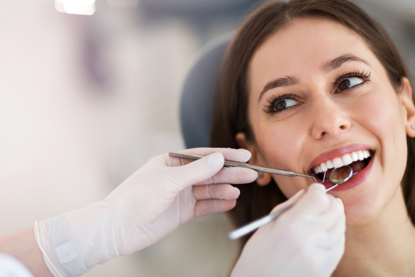 local dentist Woman having teeth examined at dentists