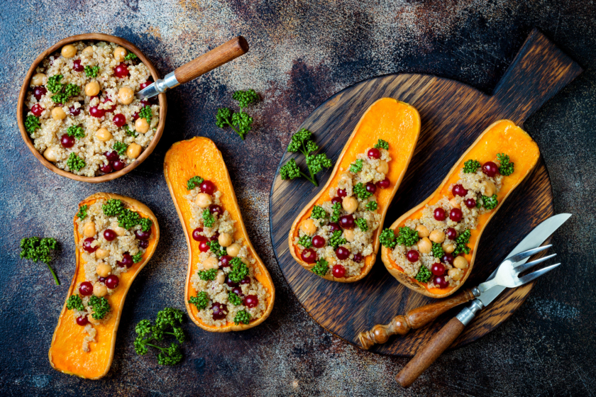 autumn recipe ideas Stuffed butternut squash with chickpeas, cranberries, quinoa cooked in nutmeg, cloves, cinnamon. Thanksgiving dinner recipe. Vegan healthy seasonal fall or autumn food