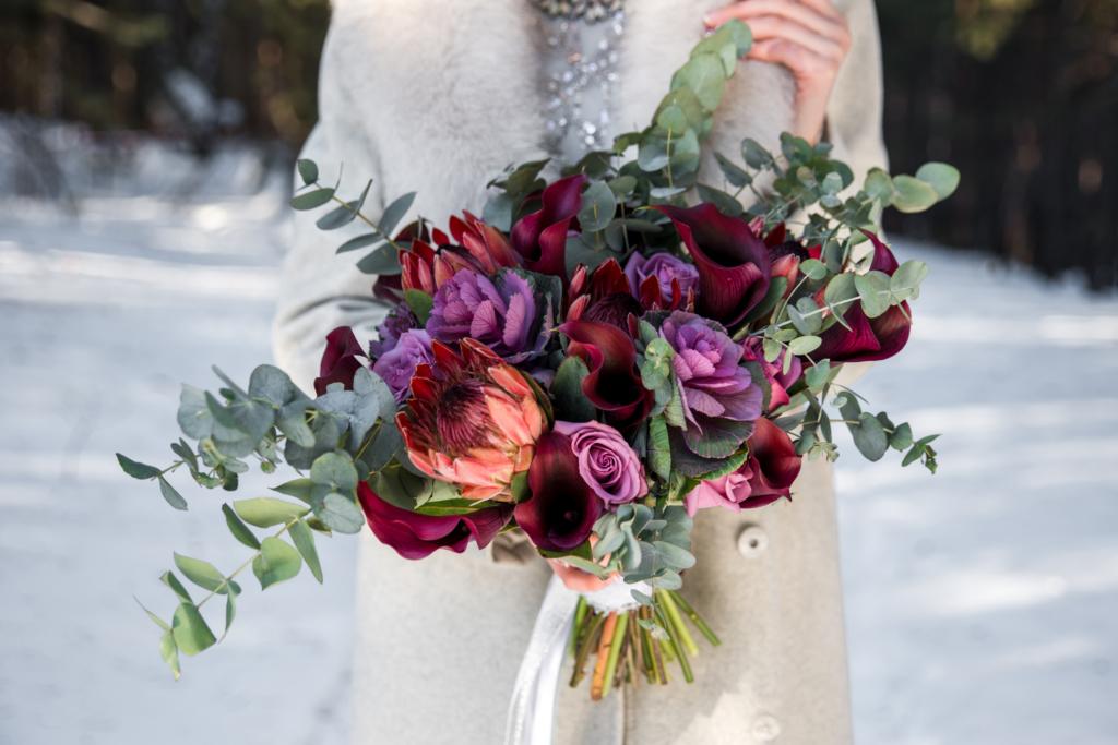 winter weddings Wedding bouquet in hands of the bride
