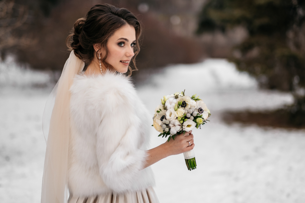 winter weddings portrait of a beautiful young woman, bride, in a winter forest