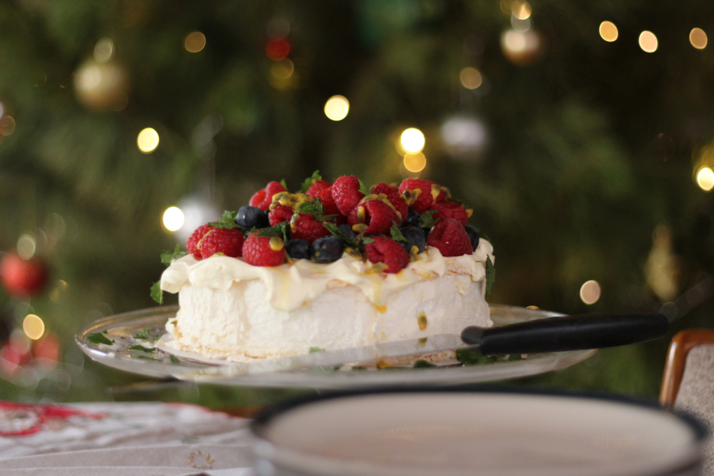 Christmas Dessert Pavlova with berries and passionfruit at Christmas time