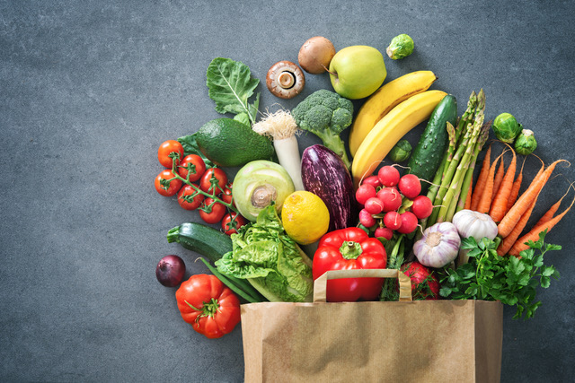 Shopping bag full of fresh vegetables and fruits for a balanced diet