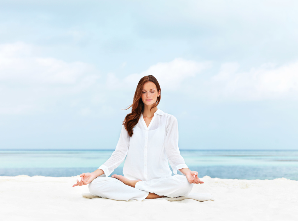 Blissful meditation for wellbeing on a beach