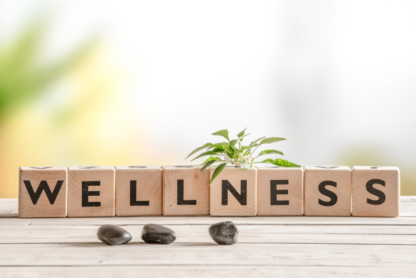 Wellness sign with wooden cubes to signal wellbeing