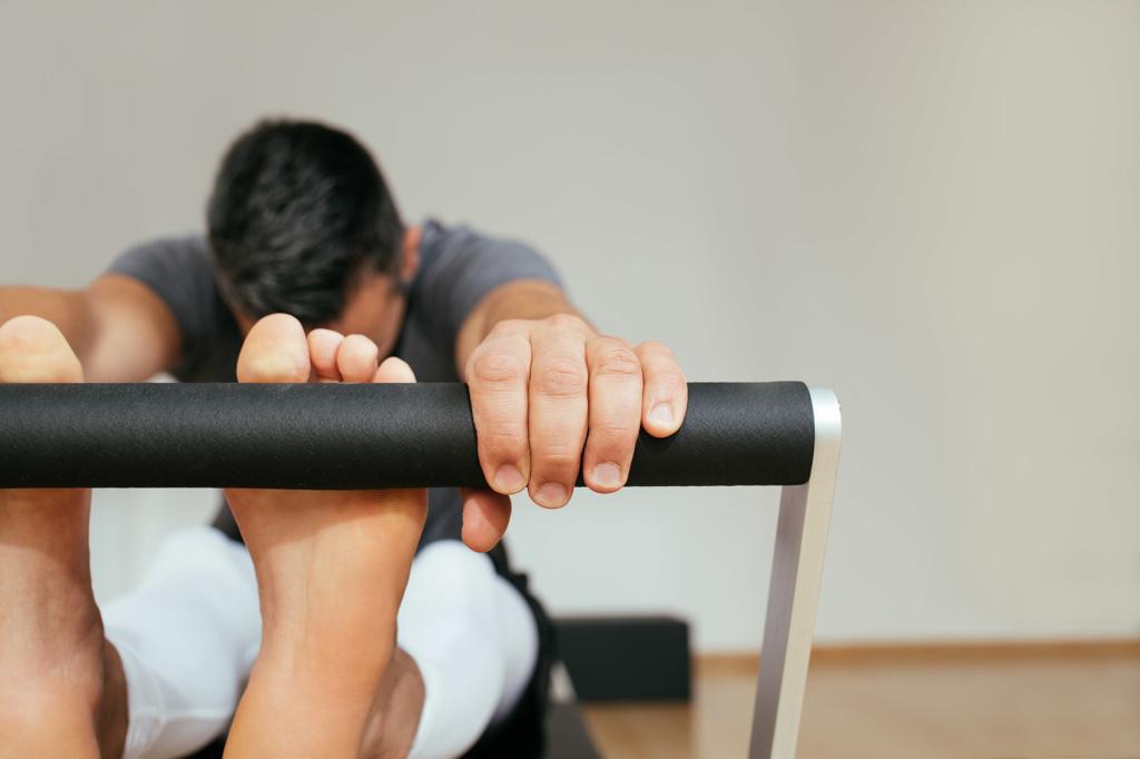 A Man Doing Reformer Pilates Class