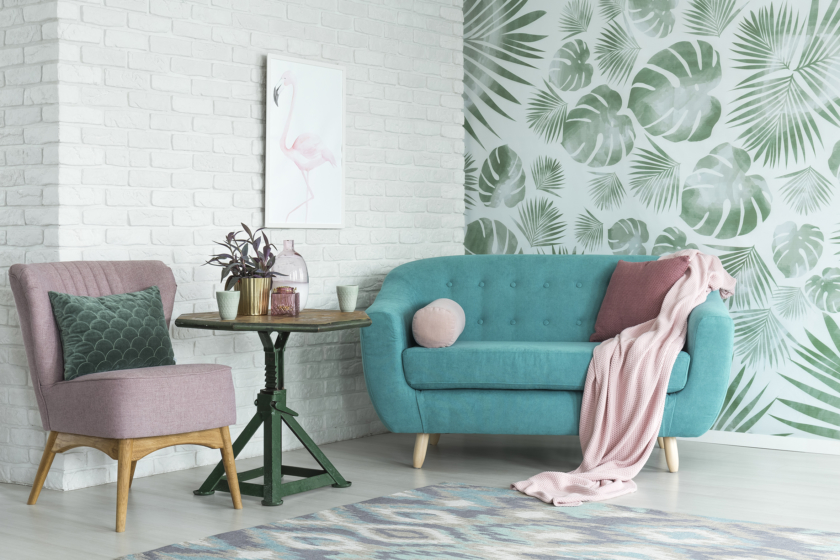 statement wallpaper with pink chair and blue sofa