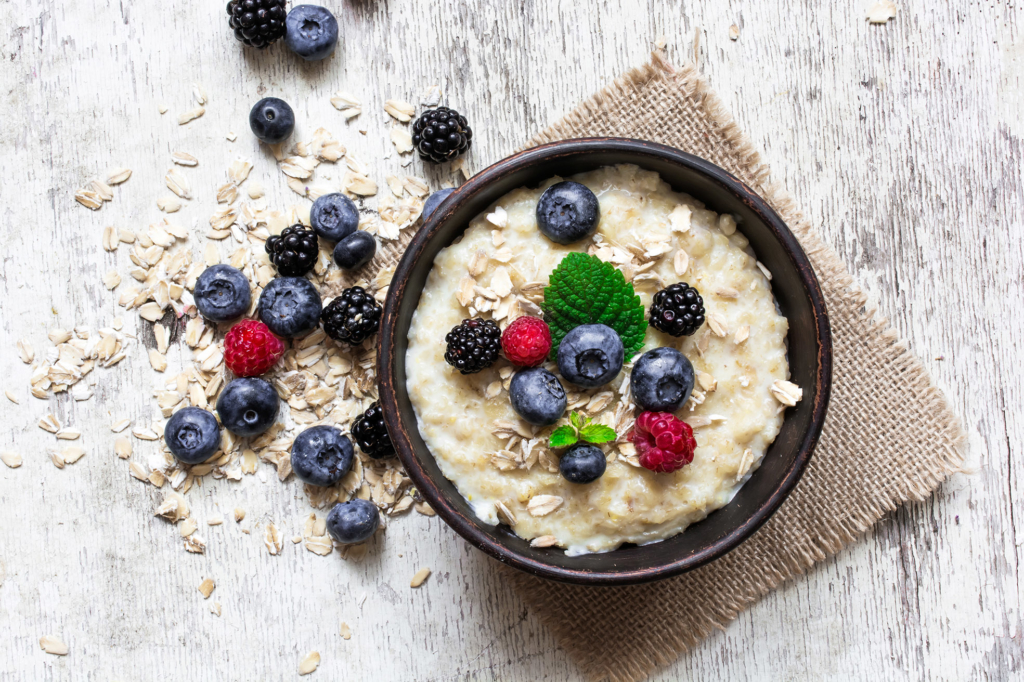 oatmeal porridge with ripe berries to improve wellbeing